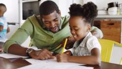 A-young-girl-doing-homework-with-her-dad