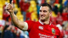 Sam Warburton gives a thumbs up at the end of the match.