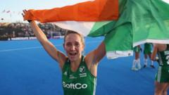 Nicci Daly holds an Irish flag