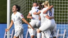 England women's football team celebrating a win.
