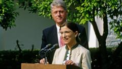 President Bill Clinton stands behind newly-confirmed Associate Justice of the Supreme Court Ruth Bader Ginsburg as she speaks in the Rose Garden of the White House, Washington DC, 3 August 1993