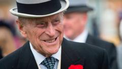 Prince Philip, Duke of Edinburgh greets guests at a garden party at Buckingham Palace in London