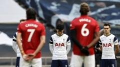 Manchester United and Tottenham Hotspur players take part in a two-minute silnmce to remember the Duke of Edinburgh