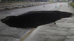 A large sinkhole which appeared in Mancunian Way, Manchester