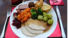 Traditional Christmas dinner with turkey, roast potatoes and Brussels sprouts.