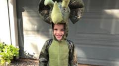 Riley in a dinosaur costume