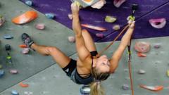 A-woman-on-a-climbing-wall.