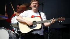 Lewis Capaldi plays his guitar at Glastonbury