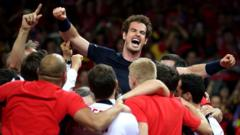 Andy Murray is mobbed by his team-mates after beating David Goffin to win the Davis Cup Final at the Flanders Expo Centre, Ghent.