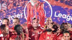 Liverpool lift the 2019/2020 Premier League trophy