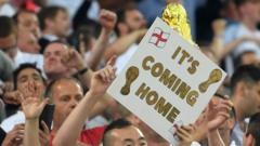 Fans holding a sign saying 'It's coming home'