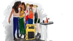 Students singing karaoke together
