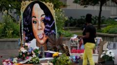 A woman visits the memorial for Breonna Taylor in Louisville