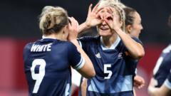 Ellen White celebrates with teammates