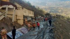 Rescue team members work outside a tunnel after a part of a glacier broke away and caused flood in Tapovan, northern state of Uttarakhand, India. Photo: 8 February 2021