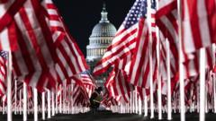 American flags in focus before the Whitehouse.