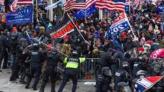 Trump supporters clash with police and security forces as they storm the US Capitol in Washington DC on 6 January 2021.