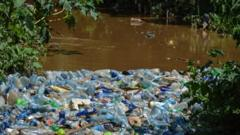 lots of plastic rubbish gathered together on a river