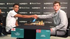 Trent Alexander-Arnold shaking hands with chess champion, Magnus Carlsen