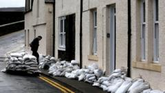 Man prepares for more flooding with sandbags in Scotland