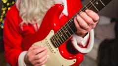 Santa playing a guitar