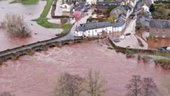 Aerial-view-of-the-Welsh-village-of-Crickhowell-which-has-been-cut-off-as-the-river-Usk-bursts-its-banks-at-Crickhowell-Bridge.