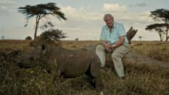 Sir David Attenborough with a rhino
