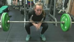 Lara Bennett lifting weights