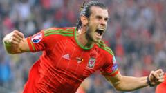 Gareth Bale celebrates after scoring the first goal for Wales