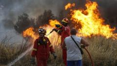 Firefighters and volunteers try to extinguish the fires
