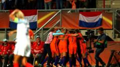 "Danielle van de Donk of The Netherlands celebrates with team mates after scoring her team""s second goal of the game during the UEFA Women""s Euro 2017 Semi Final match between Netherlands and England at De Grolsch Veste Stadium on August 3, 2017 in Enschede, Netherlands"