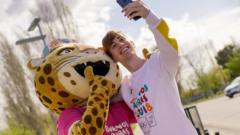 A picture of the mascot with a fan, taken on the torch's tour around the country.