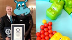 Composite image showing the mystery hungry hungry hippos record holder, camouflaged with a cartoon hippo to hide his identity. Other half of image shows game hungry hungry hipps