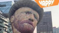 Vincent Van Gogh's face and the happy logo