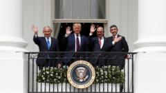 Israel, US, Bahrain and UAE leaders wave at the White House