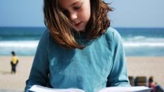Girl reading on a beach