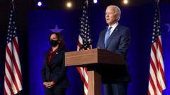 Joe Biden and Kamala Harris standing on stage