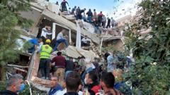 People moving rubble at a collapsed building