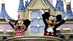 Mickey Mouse and Minnie Mouse stand on a balcony of a fantasy castle