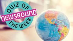 Globe next to quiz of the week logo.