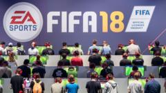 Gamers playing FIFA 18 at the Gamescom in August