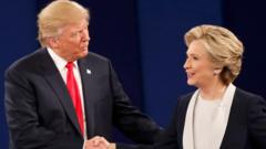 Republican U.S. presidential nominee Donald Trump and Democratic U.S. presidential nominee Hillary Clinton shake hands at the conclusion of their presidential town hall debate at Washington University in St. Louis, Missouri, U.S.
