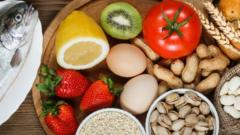 Food allergy concept. Almonds, milk, pistachios, tomato, lemon, kiwi, trout, strawberry, bread, sesame seeds, eggs, peanuts and bean on wooden table