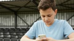 Young boy on his smartphone