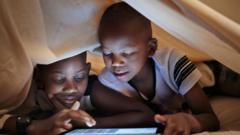 Two boys using a tablet