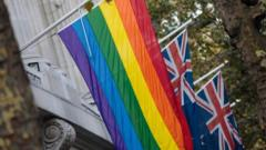 The rainbow flag hangs in front of Australian flags outside Australia House on November 16, 2017 in London, England. Australia voted yesterday to legalise same-sex marriage in a historic poll.