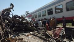 People inspect the train crash scene in Sohag province, Egypt. Photo: 26 March 2021