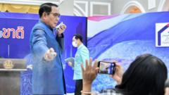 Prayuth Chan-ocha spraying reporters