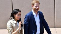 The Duchess and Duke of Sussex smiling for the cameras