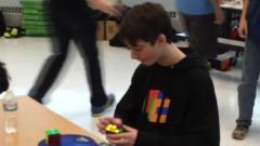 Boy completes Rubik's cube